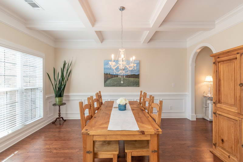 amazing dining room with waffle ceilings and baseboard trim