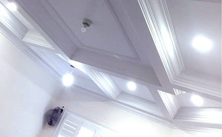 living room with amazing waffle ceiling trim