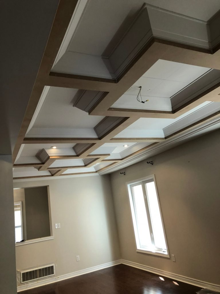 classic waffle ceiling with potlights in custom family room