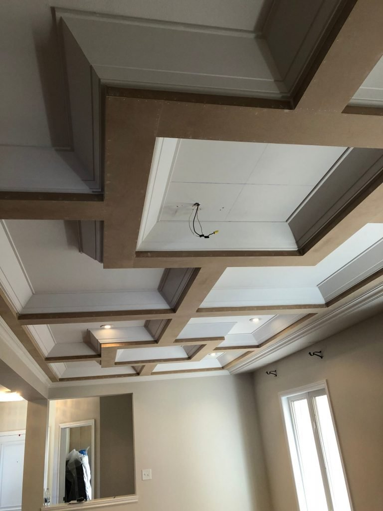 coffered ceiling trim with pot lights in custom house