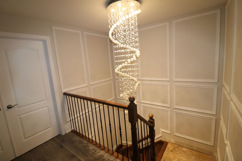second floor staircase with wainscoting decor