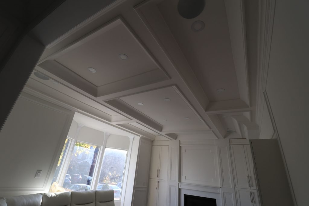 classic family room with waffle ceiling and crown moulding