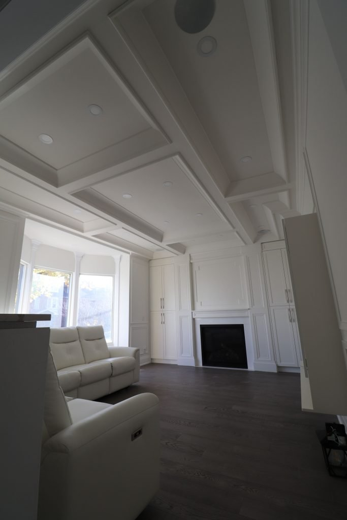custom family room with waffle ceiling