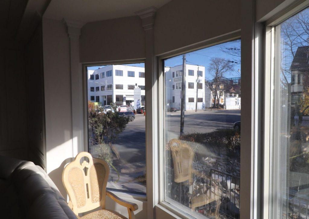 custom family room with bow window