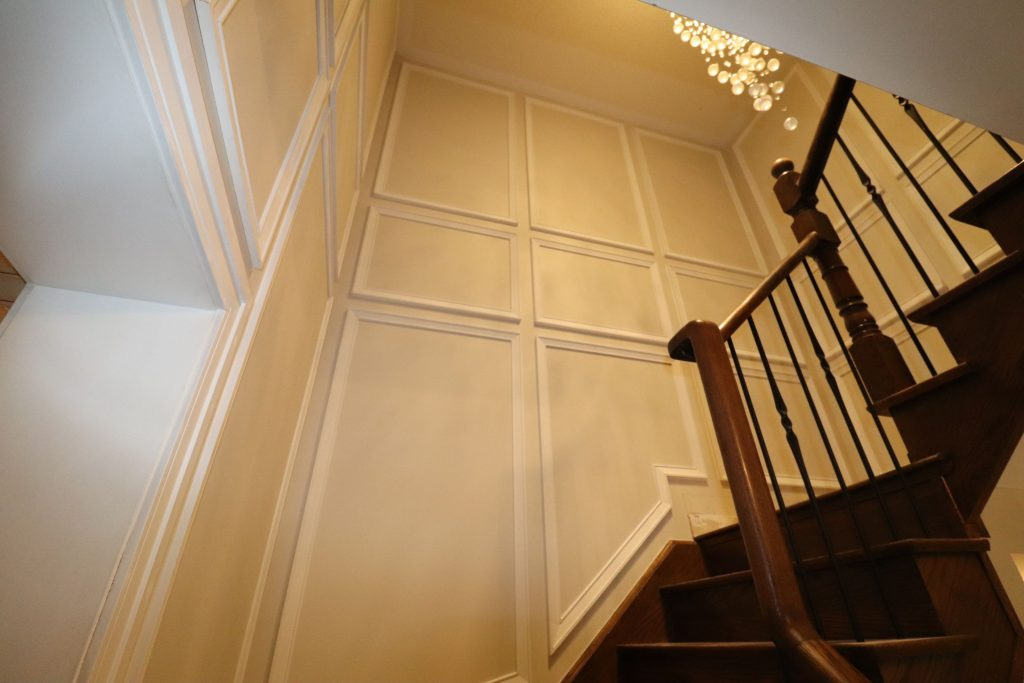 modern staircase with wainscoting wall decor