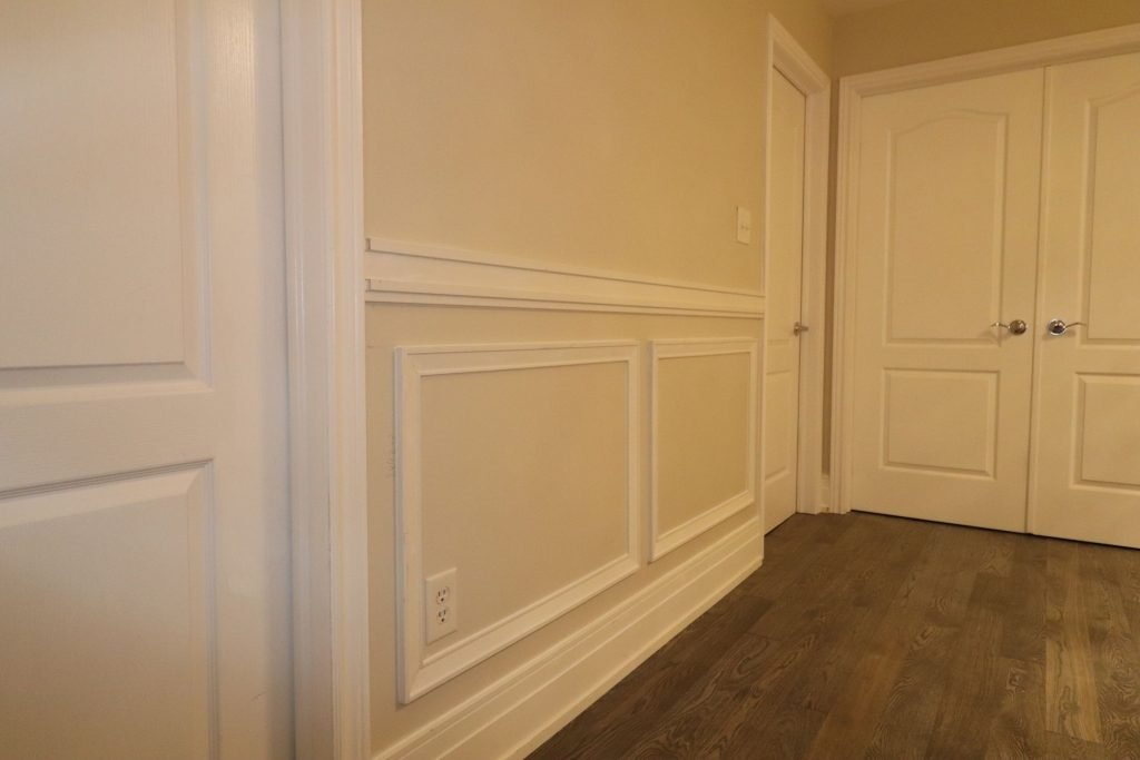 wainscotting wall decor in custom hallway