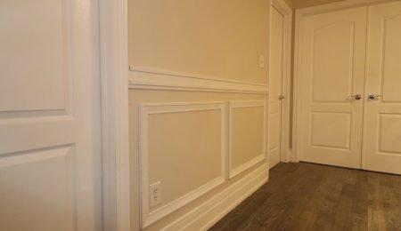 wainscotting wall decor in custom hallway