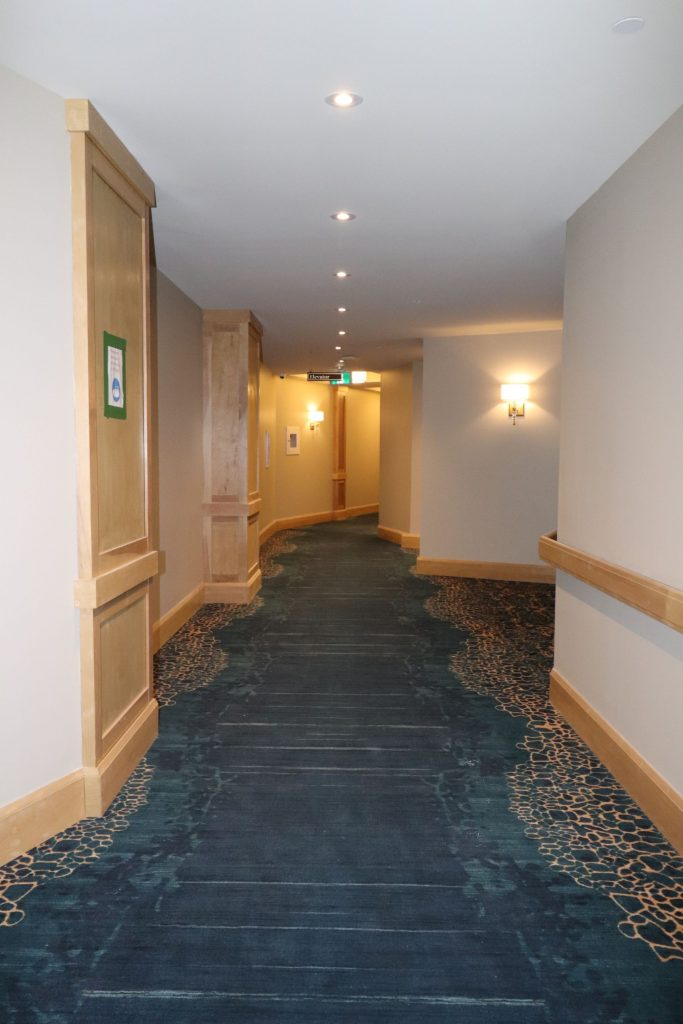 baseboard installation in commercial hallway