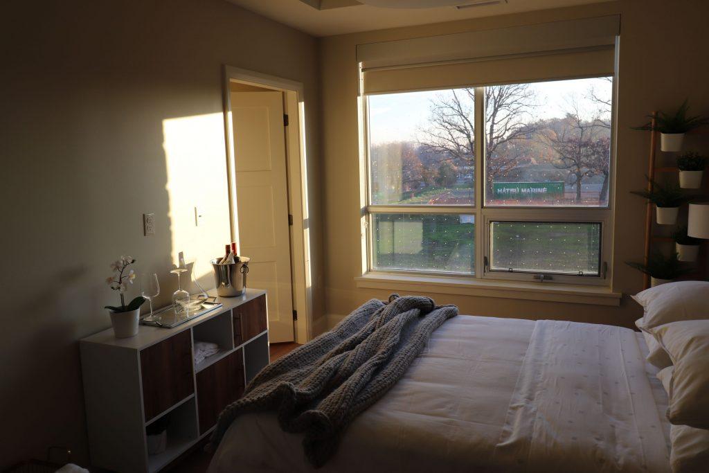 baseboard and door tim installation in custom bedroom