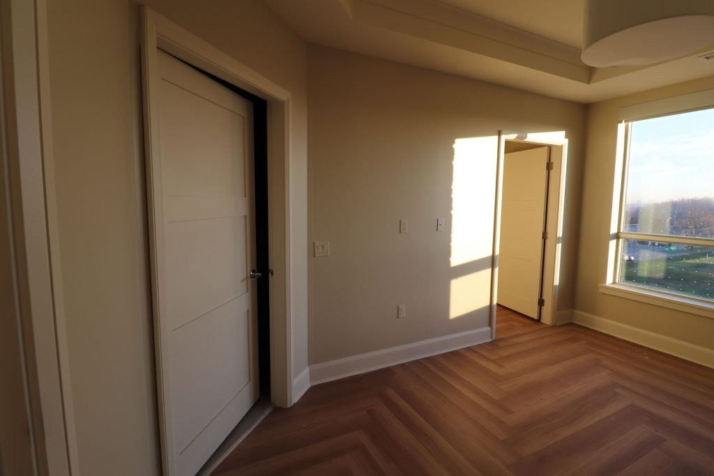 custom bedroom with baseboard trim