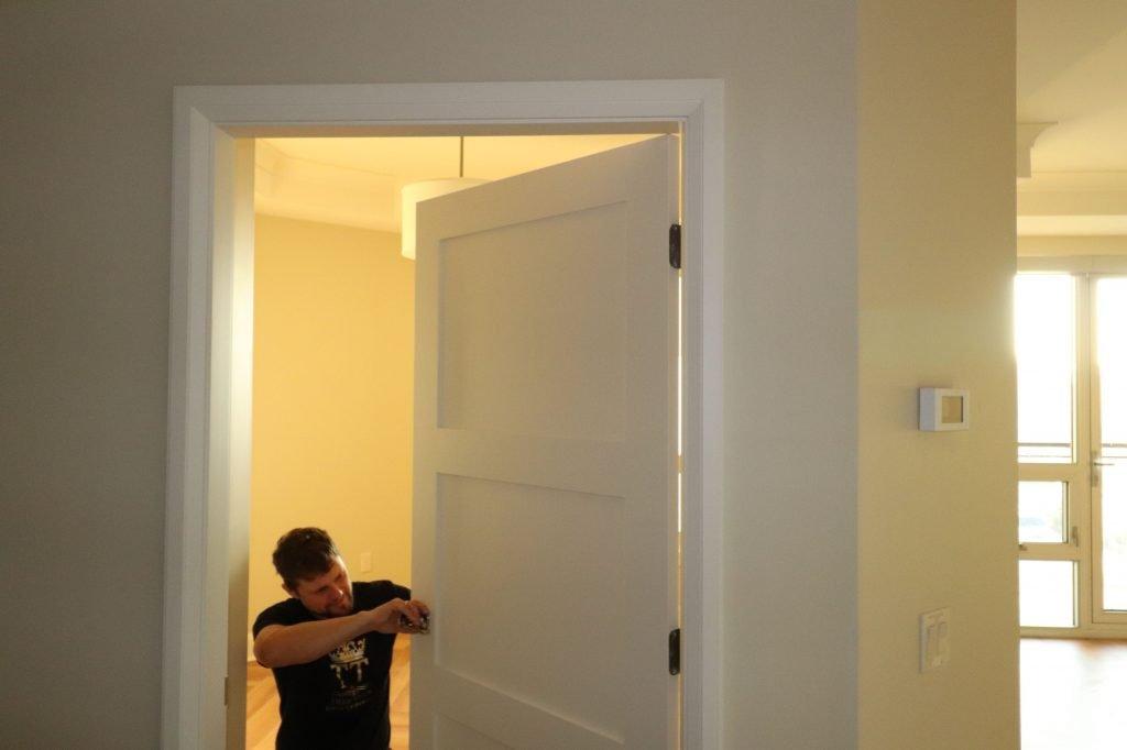 trim team installing custom door
