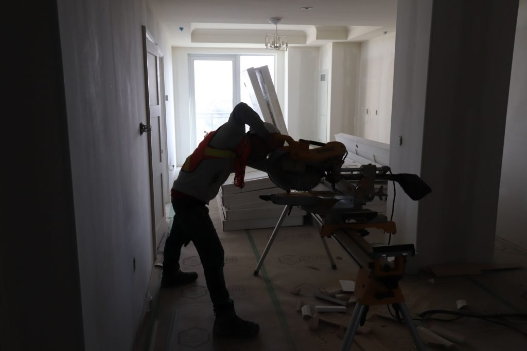 in progress of baseboard trim installation