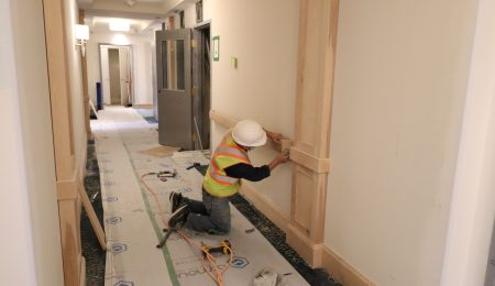 trim team installing wooden railings and baseboard trim